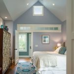 Colorful Area Rugs with Transitional Bedroom and  Vases  Teal Accents  Turquoise Accents  Bedding  Transom Windows