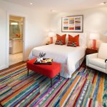 Company C Rugs with Traditional Bedroom and  Colorful Artwork  Table Lamp  Colorful  Striped Area Rug  White Bedding