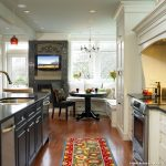 Company C Rugs with Traditional Kitchen and  Crystal Knobs  Crown Molding  Ceiling Lighting  Breakfast Nook  Banquette