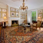 Cost Plus Rugs with Traditional Living Room and  Shutters  Leather Sofa  Large Area Rug  Gold Framed Art  Mantel
