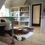 Cow Hide Rug with Contemporary Family Room and  Wall Decor  Cowhide Rug  House Plants  Wall Art  Bookcase
