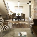 Cow Hide Rug with Traditional Family Room and  Tongue and Groove  Pendant Light  Staircase  Wood Paneling  Pillows