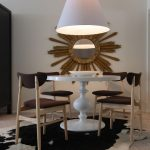 Cow Hide Rugs with Eclectic Dining Room and  Gilt Frame  Turned Base  Cow Hide Rug  White Walls     White High Gloss