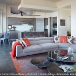 Cut a Rug with Contemporary Living Room and  Orange Throw  Cambria Countertops  Gray Wood Veneer  Curved Window  Soffit Box