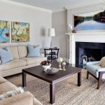 Cut a Rug with Contemporary Living Room and  White Wood  Wall Art  Dark Floor  Tan Couch  Throw Pillows