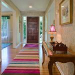 Cut a Rug with Eclectic Entry and  White Painted Trim  Side Lites  Wood Floor  Wallpaper  Carpet Runner