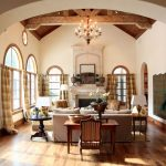 Cut a Rug with Mediterranean Living Room and  Large Area Rug  Wood Beams     Striped Curtains  Striped Drapery  Beige Walls