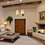 Cut a Rug with Mediterranean Living Room and  Oversized Rug  Beige Sofa  Wall Cutout  Beige Wall  Stone Fireplace Mantel