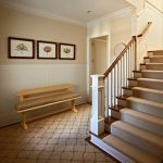 Cut a Rug with Traditional Entry and  Beige Molding  Beige Staircase  Beige Staircase Railing  Beige Patterned Carpet  Beige Column