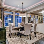 Dining Room Rugs with Eclectic Dining Room and  Pass Through  Colorado Collection  Dark Wood Floor  Round Dining Table  Patterned Rug