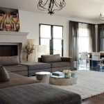 Discount Area Rugs with Contemporary Family Room and  Fireplace  Pendant Lighting  Dark Grey Sofa  Dining Area  Chandelier