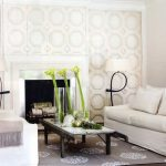Diy Area Rug with Contemporary Family Room and  Floral Arrangement  Accent Wall  Crown Molding  Monochromatic  White Linen Sofa