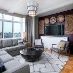 Gray and White Rug with Contemporary Living Room and  Modern Chandelier  Light Wood Flooring  Contemporary Artwork  Light Wood Parquet Flooring  Black Table