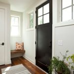 Gray and White Rug with Farmhouse Entry and  Striped Runner  White Walls  Black Door  Window Panes     Square Window