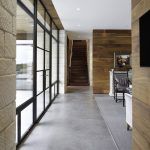 Gray Area Rugs with Contemporary Hall and  Outside Doors  Dark Wood Staircase  Window Wall  Grey Upholstered Chair  Floor to Ceiling Windows
