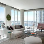 Gray Area Rugs with Contemporary Living Room and  Grey Column  Sculpture  Grey Area Rug  White Paneled Windows  Ottomans and Cubes