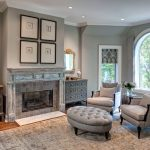 Gray Area Rugs with Traditional Living Room and  Interior Shutters  Large Grey Area Rug  White Window Trim  Gray Shutters  Arched Mirror