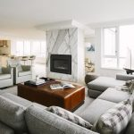 Gray Area Rugs with Transitional Family Room and  Apartment  Gray Leather Chair  Gray Leather Club Chair  Square Brown Leather Ottooman     Apartment Interior Designer
