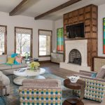 Gray Area Rugs with Transitional Living Room and  Colorful Art Work  Stained Wood Fireplace Surround  Greige Sectional  Stone Fireplace  Wood and Brushed Nickel Round Table.