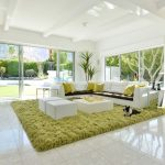 Green Shag Rug with Midcentury Living Room and  White Tile Flooring     Glass Sliding Doors  Green Shag Area Rug  Green Accent  White Sofa