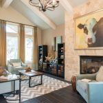 Grey Chevron Rug with Transitional Family Room and  Pale Blue Armchair  Warm Neutral Colors     Vaulted Ceiling  Exposed White Beams  Coffee Table