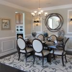 Hula Hoop Rug with Contemporary Dining Room and  Black Floor  Rectangular Dining Table  Area Rug  Wainscoting  Chair Rail