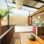 Indoor Outdoor Area Rugs with Contemporary Porch and  Palm Tree  Wood Slat Bench  Wood Porch  Integrated Kitchen  Indoor Outdoor Living