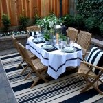 Indoor Outdoor Area Rugs with Traditional Patio and  Outdoor Rug  Tablecloth  Table Setting  Floral Arrangement  Potted Plants