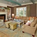 Jelly Bean Rugs with Beach Style Living Room and  Lots of Seating  Small Ottoman  Wood Coffee Table     Beige Fireplace Mantel  Beige Patterned Armchair