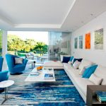 Jelly Bean Rugs with Contemporary Living Room and  Indoor/outdoor Living  Oversized Window  Colorful Art  Blue Armchair  Picture Window