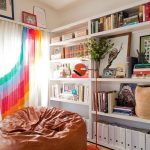 Jelly Bean Rugs with Eclectic Living Room and  Organization  Woven Rug     White Bookcase  Rainbow Window Treatment  Orange Floor Lamp