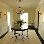 Land of Nod Rugs with Traditional Entry and  Wood Trim     Wall Art  Foyer  Wainscoting  Interior Doors