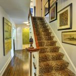 Leopard Print Rug with Traditional Staircase and  Finial  Framed Wall Art  Newel Post  Stair Runner     Leopard Print