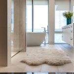 Luxury Bath Rugs with Contemporary Bathroom and  Accent Tile  Egg Shaped Tub  Large Window  Sophisticated  Freestanding Faucet