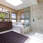 Luxury Bath Rugs with Traditional Bathroom and  Skylights  Frameless Shower Enclosure  Neutral Tones  Double Vanity  Double Sinks