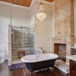 Memory Foam Bath Rugs with Transitional Bathroom and  Unused Fireplace  Old Fireplace  Chandelier  Brick Walls  Rustic Wood