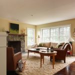Mohawk Area Rugs with Traditional Living Room and  Fireplace Mantel  Wood Trim  Open Living Room  Patio Doors  Double Hung Windows