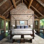 Natural Area Rugs with Rustic Bedroom and  Beams  Stone Interior Wall  Canopy Four Poster Bed  Vaulted Ceilings  Dark Hardwood Floors