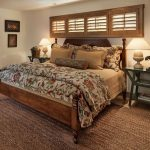 Natural Area Rugs with Rustic Bedroom and  White Ceiling  Pillow Shams  Framed Artwork  Beige Bedding  White Walls