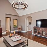 Natural Area Rugs with Traditional Family Room and  Wood Coffee Table  Hardwood Floor  Cathedral Ceiling  Entertainment Console  Artwork