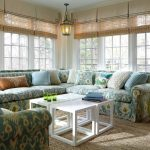 Natural Area Rugs with Traditional Sunroom and  Natural Area Rug  Ikat Fabric  Pendant Light  Green Ceramic Stool  White Coffee Table
