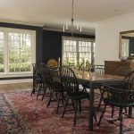 Navy and White Rug with Traditional Dining Room and  Dark Walls  Wood Molding		 					 		  		  White Wood  Windsor Dining Chair  Chandelier