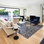 Navy and White Rug with Transitional Living Room and  White Walls		 					 		  		  Indoor Outdoor  Light Wood Floor  		Abstract Art  Jute Rug