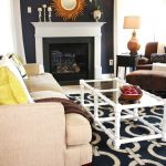 Navy and White Rug with Transitional Living Room and  White Wood  Key Rug  Sunburst Mirror  Dark Walls  Glass Coffee Table