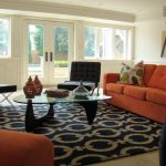 Navy Blue Rug with Contemporary Family Room and  Glass Coffee Table  French Doors  Leather Chair  Black Leather  Wainscot