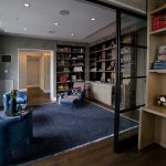 Navy Blue Rug with Contemporary Family Room and  Wine Fridge     Book Shelves  Navy Rug  Built in Bookcase  Blue Chairs