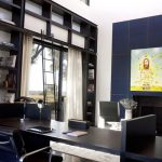Navy Blue Rug with Contemporary Home Office and  Natural Light  Freestanding Desk  Metal Ladder  Lots of Light  White Curtains