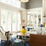 Navy Blue Rug with Transitional Family Room and  Beige Molding  Beige Wainscoting  Black Patterned Rug  Beige Side Chair  Floor to Ceiling Windows