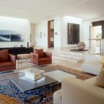Oriental Rug Cleaning with Contemporary Living Room and  Artwork  Recessed Ceiling Lighting  White Walls     Sunken Living Room  Sectional Tan Sofa