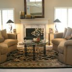 Oriental Rug Cleaning with Contemporary Living Room and  Marble Fireplace  Tan     Curved Sofa  Glass Coffee Table  Mirror